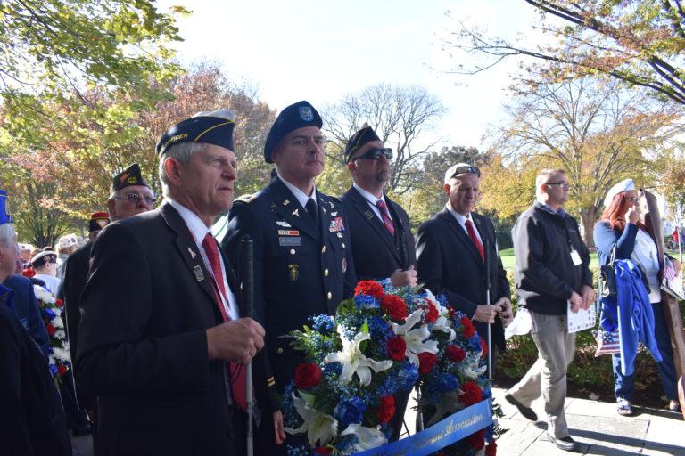 Four Veterans Celebrating at the Veterans Day Parade