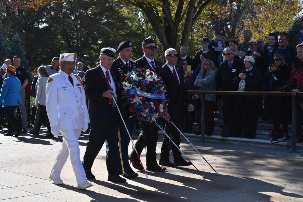 Five veterans walking in Veterans Day Parade