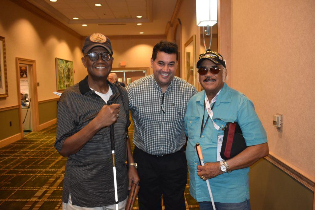 Enrique with Ronald White and Enrique's son.