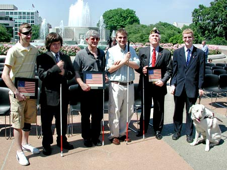 6 Members in front of a Fountain, along with a seeing eye dog.
