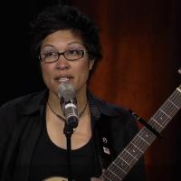Dani Figueroa playing a guitar